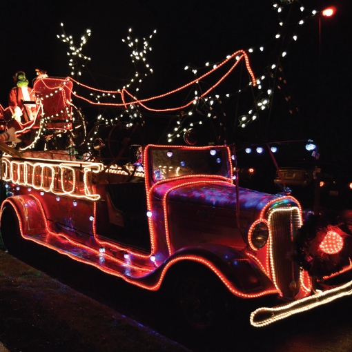 Vintage fire truck lit with holiday lights
