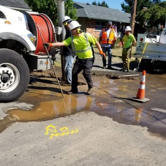 Workers repairing water issue outside