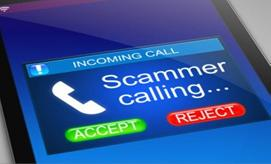 Cell phone displaying a warning that a scammer is calling